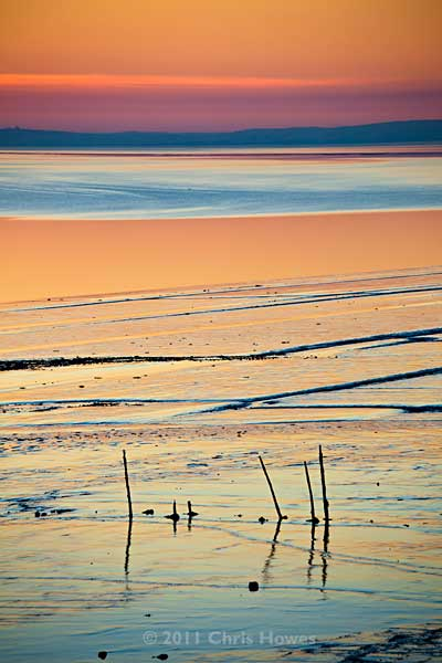 Sunset over the beach and mudflats at Goldcliff near Newport, Gwent, Wales, UK